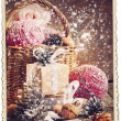 Vintage Christmas Card with Gifts and falling snow — Stock Photo #32498371