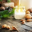 Christmas Table with Candles, Gifts and Nuts — Stock Photo #35175293
