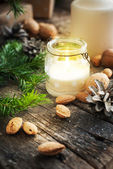 Christmas Table with Candles, Gifts and Nuts — Stock Photo