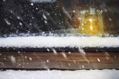 Oil Lamp on the Wooden Window and Falling Snow — Stock Photo