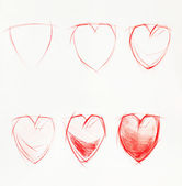 Stages of drawing heart, pencil — Stock Photo