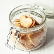 Jar with Hearts Cookies on white wooden table — ストック写真