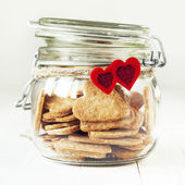 Cookies in the Jar Decorated with Two Red Hearts — Stock Photo