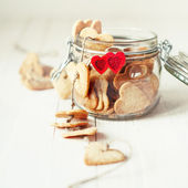Festive Cookies in Jar Decorated with Hearts — Fotografia Stock