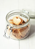Jar with Hearts Cookies on white wooden table — Stok fotoğraf