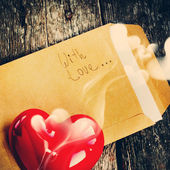 Valentine Letter with Red Aromatic Candle, toning — Stock Photo