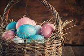 Easter Colored Eggs in the Basket, toned — Stock Photo