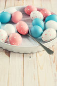 Easter Eggs on white plate — Stock Photo