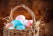 Easter Eggs Painted Pink, Blue in the Basket — Stock Photo