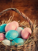 Easter Eggs Painted with peas lies in a basket — Stock Photo