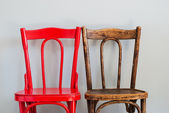 Chairs on a Grey Wall — Stock Photo
