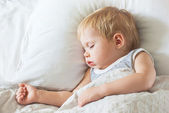 Sweet Little Boy Sleeping on Bed — Stock Photo