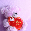 Valentines Teddy bear with red love heart - Stock Photo — Stock Photo