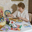 Happy elderly wom- artist makes decoupage — Zdjęcie stockowe #13920223