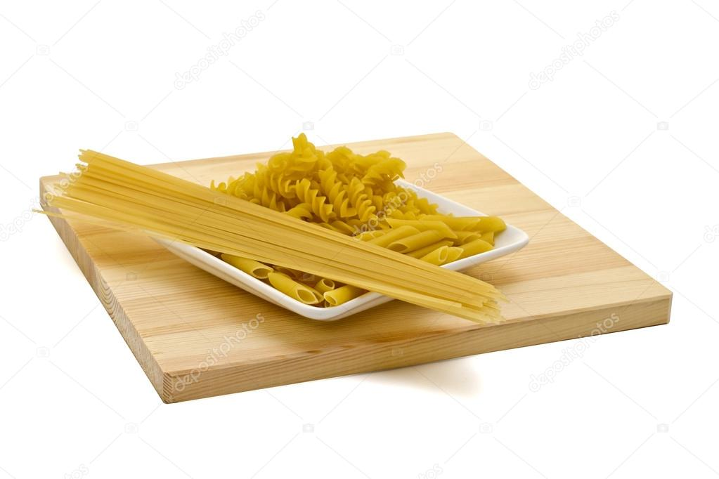 Pasta on a plate are isolated on a white background  Stock Photo #14096630