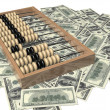 Abacus and money — Stock Photo #17740483