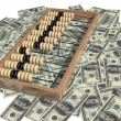 Abacus and money — Stock Photo #18572691