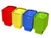 Empty colorful shopping baskets — Stock Photo