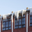 Dangerous icicles on the roof — Stock Photo