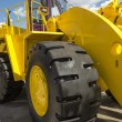 Stock Photo: Yellow road building powerful wheeler