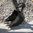 Excavator bucket on a background of rubble — Stock Photo