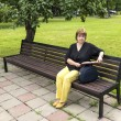 Stock Photo: Womplans to work dent sitting in park in lunch break