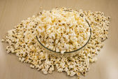Glass bowl of popcorn on the table — Stock Photo
