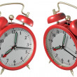 Stock Photo: Red alarm clock - angle 1 and 2. 3d render