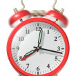 Foto Stock: Red alarm clock ringing.