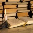 Gospel New Testament, candle and other books — Stock Photo #33369457