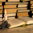 Gospel New Testament, candle and other books — Stock Photo