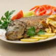 Fried carp with potato and vegetables — Stock Photo
