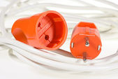 Electric plug and socket red color on white wires — Stock Photo