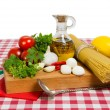 Spaghetti and ingredients for cooking sauce — Stock Photo #49400271