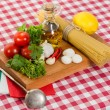 Spaghetti and ingredients for cooking sauce — Stock Photo #49400275