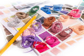Needlework. Embroidery. Match colors of thread. — Stock Photo
