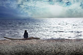 Woman reflecting on the beach — Stock Photo