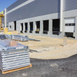 At the construction site of large warehouse — Stock Photo #13890206
