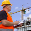 Stock Photo: Male worker at Construction site with plan