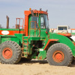 Royalty-Free Stock Photo: Green loader on sand