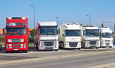 Trucks in a row — Stock Photo