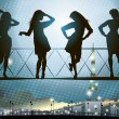 Royalty-Free Stock Vector Image: Silhouettes of females on abstract background