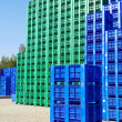 Stock Photo: Plastic Crates in Warehouse