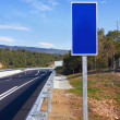 Road with blue sign pole — Stock Photo #18430631