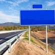 Road sign along a highway — Foto Stock