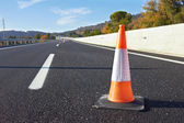 Traffic cone on a speedway — Stock Photo