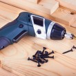 Stock Photo: Screws and screwdriver