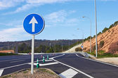 Road sign along a highway — Stock Photo