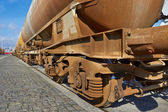 Chain of cargo wagons — Stock Photo