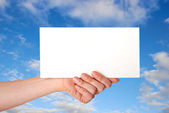 Hand with envelope — Stock Photo